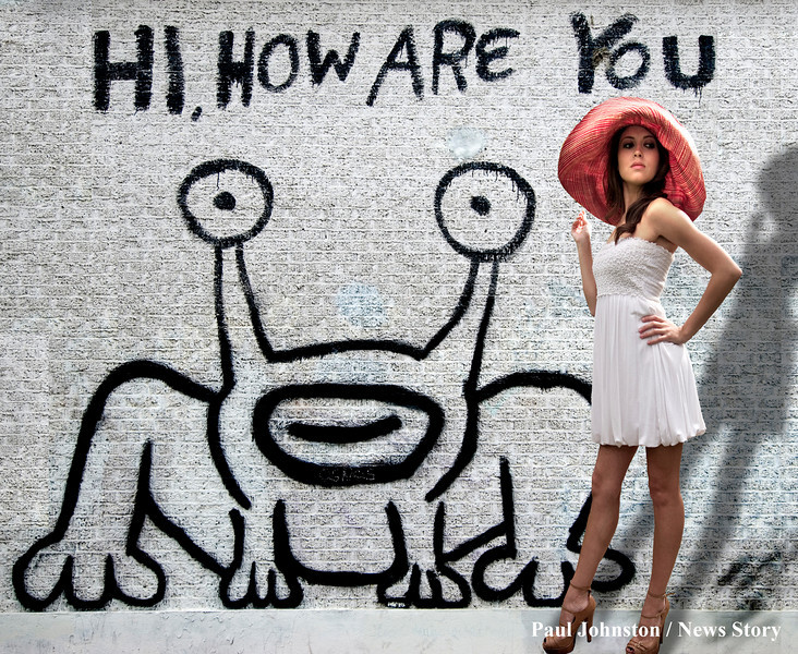 "Model Ashley in front of the famous ""Alien Frog"" mural. This mural is located on the northwest corner of Guadalupe and 21st street in Austin. It is right across from the UT campus, diagonally across from Dobie Mall. Copyright - Paul Johnston / Austin News Story - austinnewsstory.com"